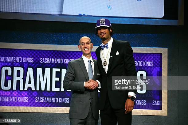 Willie CauleyStein shakes hands with NBA Commissioner Adam Silver after being selected number sixth overall by the Sacramento Kings during the 2015...
