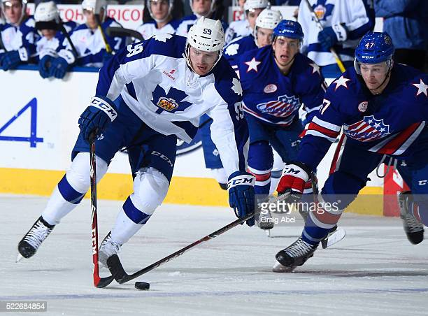 Willie Corrin of the Toronto Marlies controls the puck against Colby Robak of the Rochester Americans during AHL game action on April 17 at Ricoh...