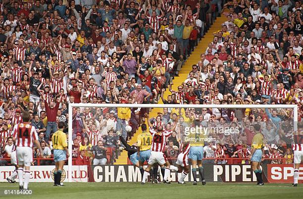 Willie Falconer of Sheffield United scores the opening goal as the United fans celebrate behind the goal during the FA Carling Premiership match...