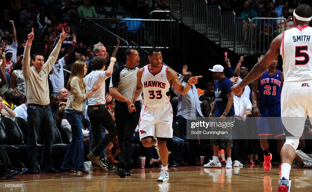 <a gi-track='captionPersonalityLinkClicked' href=/galleries/search?phrase=Willie+Green&family=editorial&specificpeople=201653 ng-click='$event.stopPropagation()'>Willie Green</a> #33 of the Atlanta Hawks celebrates during a game against the New York Knicks on March 30, 2012 at Philips Arena in Atlanta, Georgia.