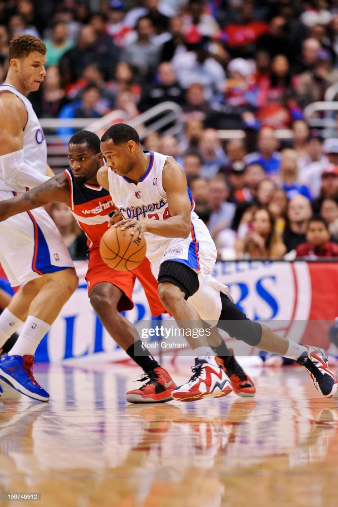 Willie Green #34 of the Los Angeles Clippers drives against Martell Webster #9 of the Washington Wizards at Staples Center on January 19, 2013 in Los Angeles, California.