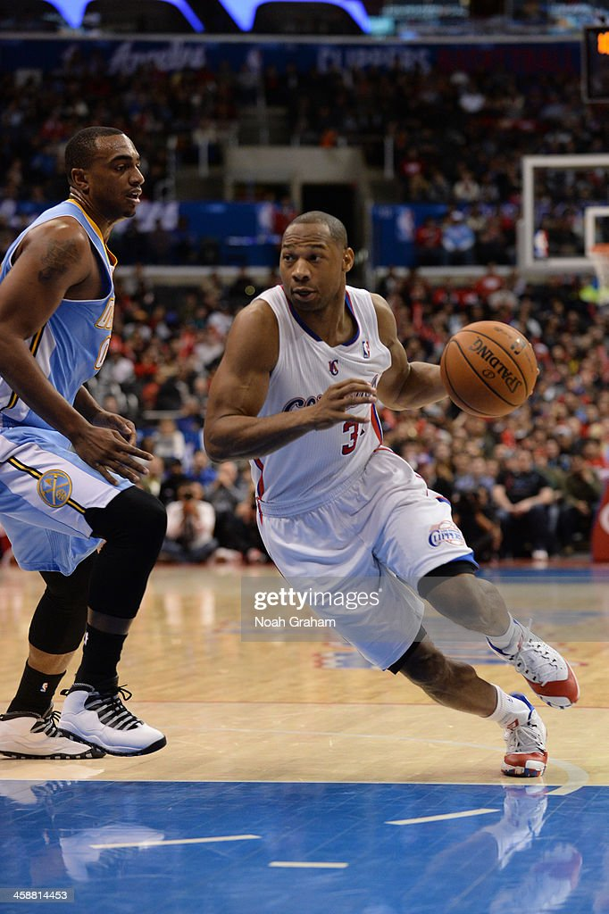 <a gi-track='captionPersonalityLinkClicked' href=/galleries/search?phrase=Willie+Green&family=editorial&specificpeople=201653 ng-click='$event.stopPropagation()'>Willie Green</a> #34 of the Los Angeles Clippers drives to the basket during a game against the Denver Nuggets at STAPLES Center on December 21, 2013 in Los Angeles, California.