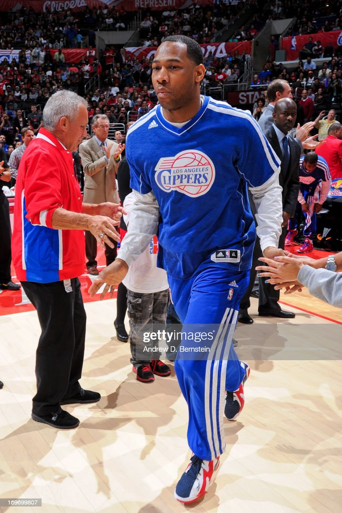 <a gi-track='captionPersonalityLinkClicked' href=/galleries/search?phrase=Willie+Green&family=editorial&specificpeople=201653 ng-click='$event.stopPropagation()'>Willie Green</a> #34 of the Los Angeles Clippers greets fans before playing against the Washington Wizards at Staples Center on January 19, 2013 in Los Angeles, California.