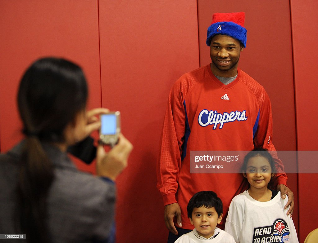 Willie Green #34 of the Los Angeles Clippers poses for a photo during the Clippers' 'Season of Giving' Adopt a Family event on December 20, 2012 at Salvation Army Seimon Family Youth & Community Center in Los Angeles, California.