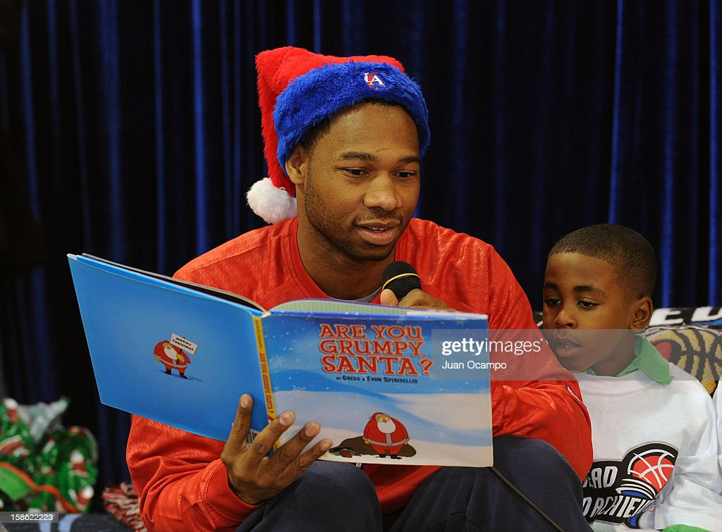 Willie Green #34 of the Los Angeles Clippers reads to the kids during the Clippers' 'Season of Giving' Adopt a Family event on December 20, 2012 at Salvation Army Seimon Family Youth & Community Center in Los Angeles, California.