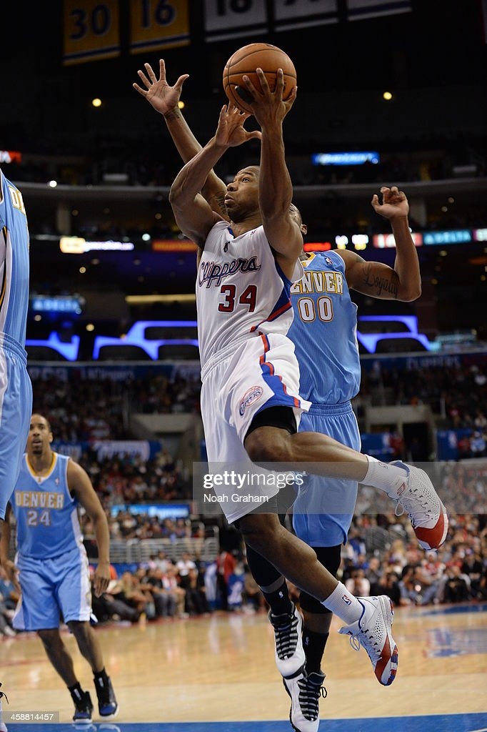 <a gi-track='captionPersonalityLinkClicked' href=/galleries/search?phrase=Willie+Green&family=editorial&specificpeople=201653 ng-click='$event.stopPropagation()'>Willie Green</a> #34 of the Los Angeles Clippers shoots during a game against the Denver Nuggets at STAPLES Center on December 21, 2013 in Los Angeles, California.