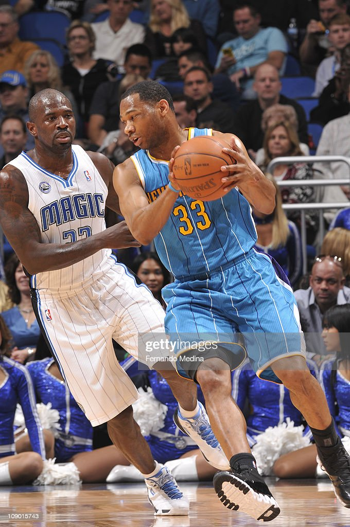 <a gi-track='captionPersonalityLinkClicked' href=/galleries/search?phrase=Willie+Green&family=editorial&specificpeople=201653 ng-click='$event.stopPropagation()'>Willie Green</a> #33 of the New Orleans Hornets drives to the basket against <a gi-track='captionPersonalityLinkClicked' href=/galleries/search?phrase=Jason+Richardson+-+Basketball+Player+-+Born+1981&family=editorial&specificpeople=201558 ng-click='$event.stopPropagation()'>Jason Richardson</a> #23 of the Orlando Magic during the game on February 11, 2011 at the Amway Center in Orlando, Florida.