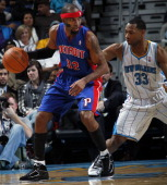 Willie Green of the New Orleans Hornets guards Richard Hamilton of the Detroit Pistons on December 8 2010 at the New Orleans Arena in New Orleans...