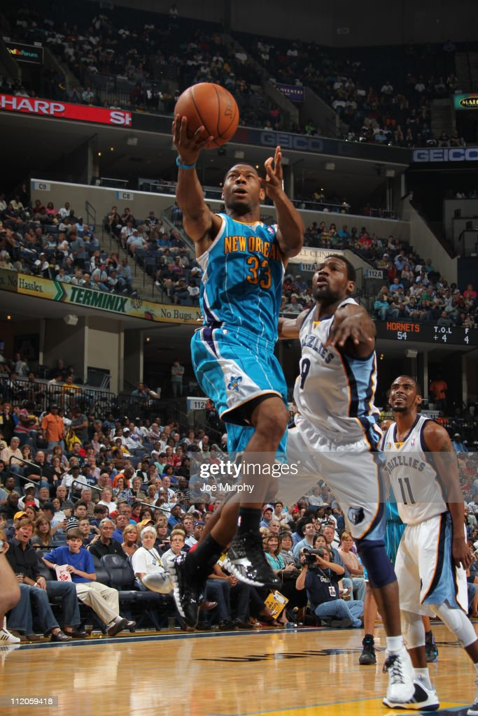 <a gi-track='captionPersonalityLinkClicked' href=/galleries/search?phrase=Willie+Green&family=editorial&specificpeople=201653 ng-click='$event.stopPropagation()'>Willie Green</a> #33 of the New Orleans Hornets shoots against <a gi-track='captionPersonalityLinkClicked' href=/galleries/search?phrase=Tony+Allen+-+Basketball+Player&family=editorial&specificpeople=201665 ng-click='$event.stopPropagation()'>Tony Allen</a> #9 of the Memphis Grizzlies during the game on April 10, 2011 at FedExForum in Memphis, Tennessee.