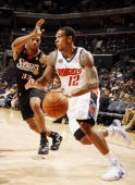 Willie Green of the Philadelphia 76ers guards against Shannon Brown of the Charlotte Bobcats on November 24 2008 at the Time Warner Cable Arena in...