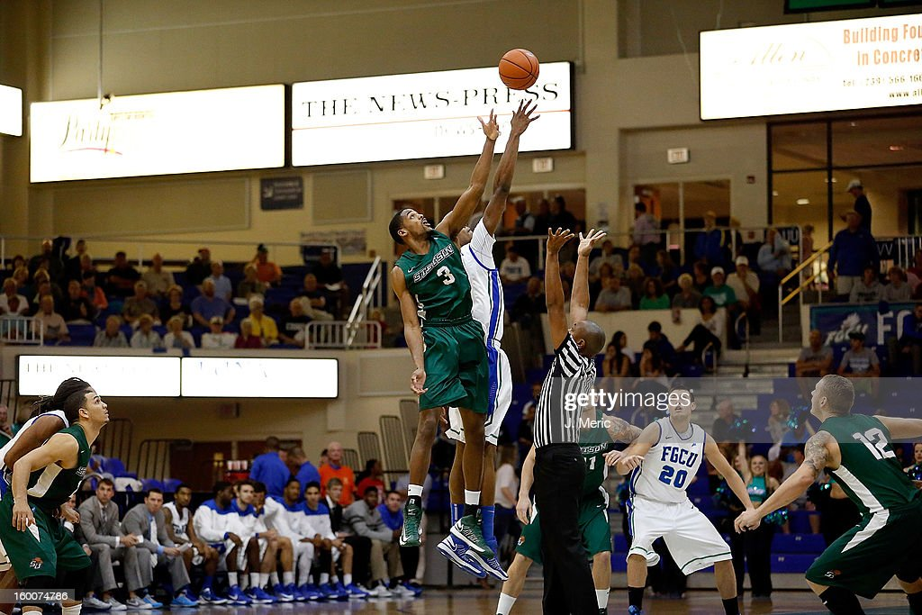 <a gi-track='captionPersonalityLinkClicked' href=/galleries/search?phrase=Willie+Green&family=editorial&specificpeople=201653 ng-click='$event.stopPropagation()'>Willie Green</a> #3 of the Stetson Hatters wins the opening tip against Eric McKnight #12 of the Florida Gulf Coast University Eagles during the game at Alico Arena on January 25, 2013 in Ft. Myers, Florida.