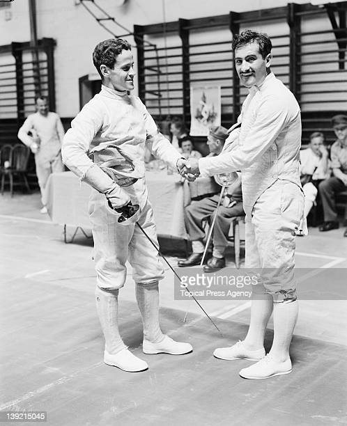 Willie Grut of Sweden shaking hands with Alberto Moreiras of Spain in the second fencing leg of the modern pentathlon event at Aldershot Hampshire...