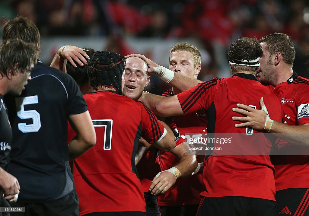 Willie Heinz of the Crusaders is congratulated by team mates after his try during the round six Super Rugby match between the Crusaders and the Kings at AMI Stadium on March 23, 2013 in Christchurch, New Zealand.