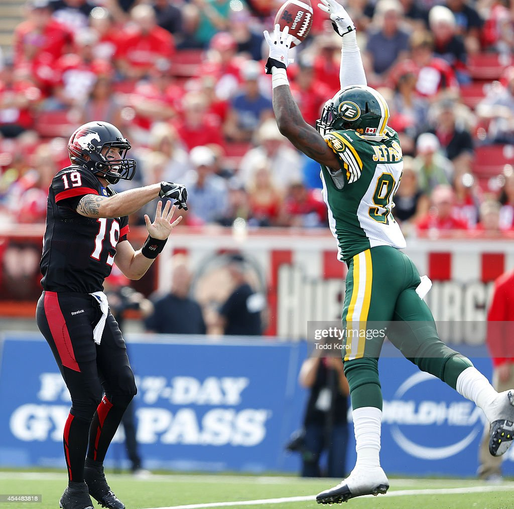 Willie Jefferson #99 of the Edmonton Eskimos blocks the pass of quarterback Bo Levi Mitchell #19 of the Calgary Stampeders during the first half of their CFL football game September 1, 2014 at McMahon Stadium in Calgary, Alberta, Canada.