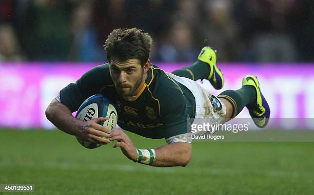 Willie Le Roux of South Africa dives over for a try during the International match between Scotland and South Africa at Murrayfield Stadium on...