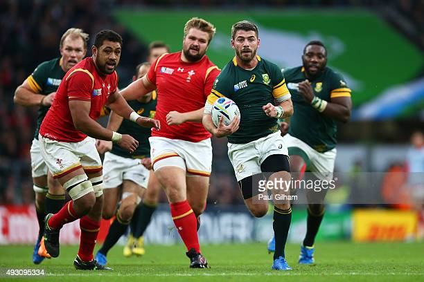 Willie Le Roux of South Africa makes a break during the 2015 Rugby World Cup Quarter Final match between South Africa and Wales at Twickenham Stadium...