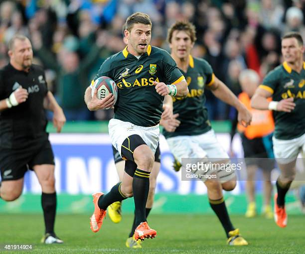Willie le Roux of South Africa scores the opening try during The Castle Lager Rugby Championship 2015 match between South Africa and New Zealand at...