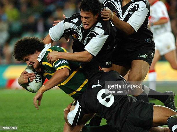 Willie Mason is taken down in a tackle by logan Swan and Willie Talau during the Kiwis 486 thrashing at the hands of the Kangaroos in the rugby legue...