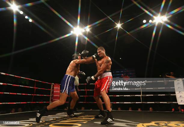 Willie Mason of league takes a punch from Troy Flavell of rugby during the bout between Willie Mason and Troy Flavell during the 2012 Fight for Life...