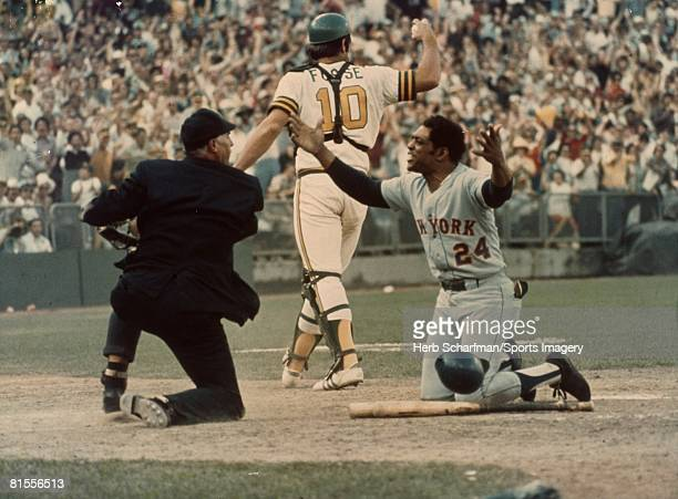 Willie Mays of the New York Mets throws his hands up as he is called out at the plate during the 1973 World Series against the Oakland Athletics in...