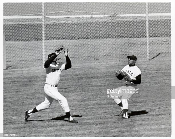 Willie Mays of the San Francisco Giants watches as teammate Willie McCovey gets under a fly ball for the catch during their World Series game against...