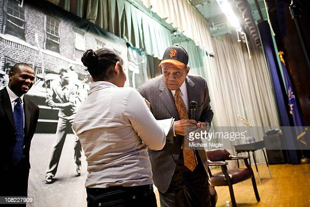 Willie Mays right answers questions from students during a visit to PS 46 in Harlem next to the site of the former Polo Grounds where the new York...