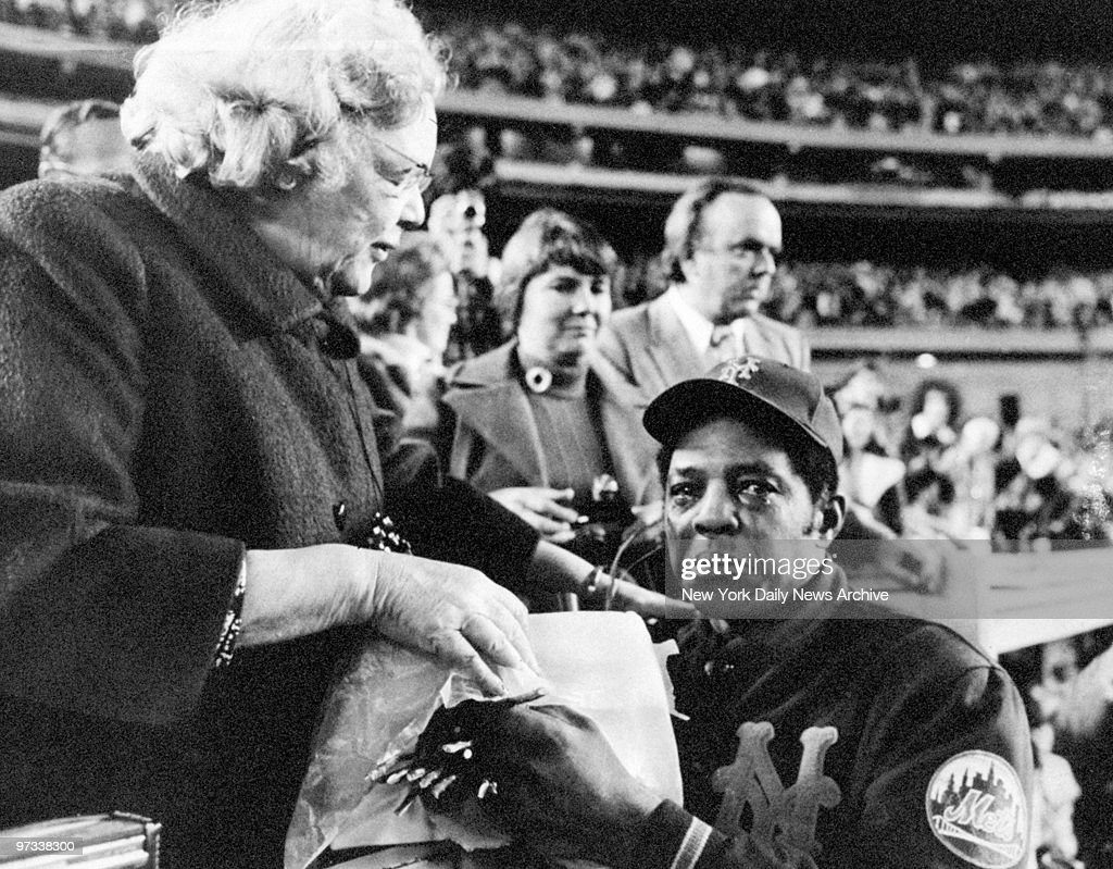 Willie Mays weeps as he is is bid farewell by New York Mets' owner Joan Whitney Payson during ceremonies for Mays at Shea Stadium. Mays retired from baseball after playing one year with the Mets.