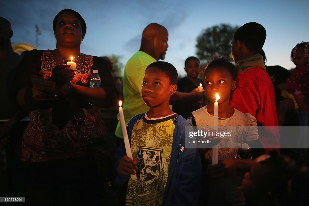 Willie McGilll and Lataiss-Jah McGill (L-R) gather with others for a candle light vigil at Fort Mellon Park to mark the one year anniversary of when Trayvon Martin was killed on February 26, 2013 in Sanford, Florida. Martin was shot by George Zimmerman on February 26, 2012 while Zimmerman was on neighborhood watch patrol in the gated community of The Retreat at Twin Lakes in Sanford, Florida.