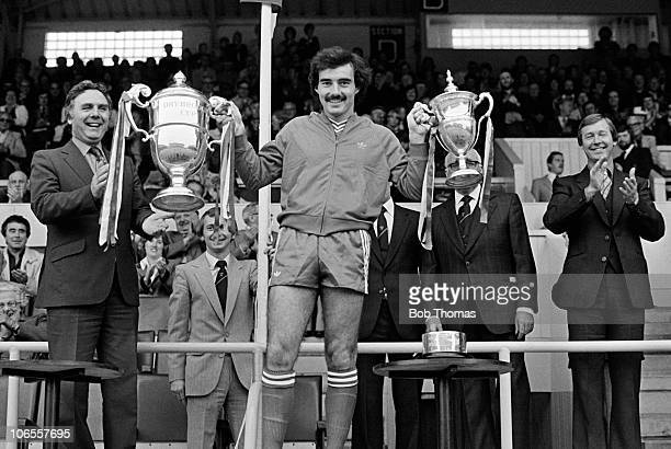 Willie Miller with the Drybrough Cup and the Scottish Premier Division Championship trophy after Aberdeen had won the preseason tournament at...