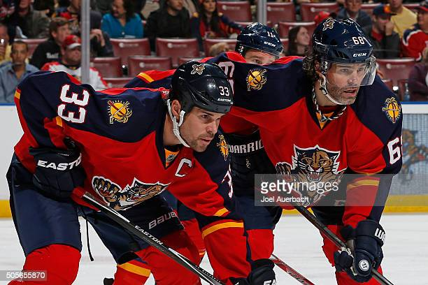 Willie Mitchell and Jaromir Jagr of the Florida Panthers prepare for a faceoff against the Edmonton Oilers at the BBT Center on January 18 2016 in...