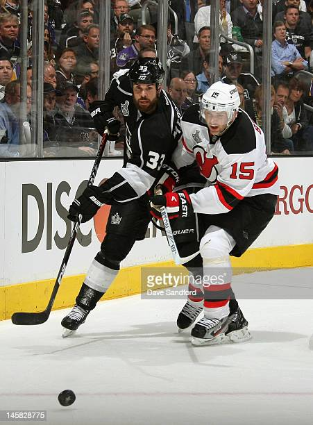 Willie Mitchell of the Los Angeles Kings and Petr Sykora of the New Jersey Devils battle for the puck during the first period of Game Four of the...