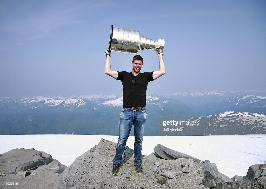 <a gi-track='captionPersonalityLinkClicked' href=/galleries/search?phrase=Willie+Mitchell+-+Ice+Hockey+Player&family=editorial&specificpeople=12876291 ng-click='$event.stopPropagation()'>Willie Mitchell</a> #33 of the Los Angeles Kings holds up the Stanley Cup at the top of Mount Benedict August 12, 2012 near Port McNeill, British Columbia, Canada. Mitchell took the Stanley Cup to his hometown of Port McNeill, B.C. for his one-day celebration with the prized trophy.