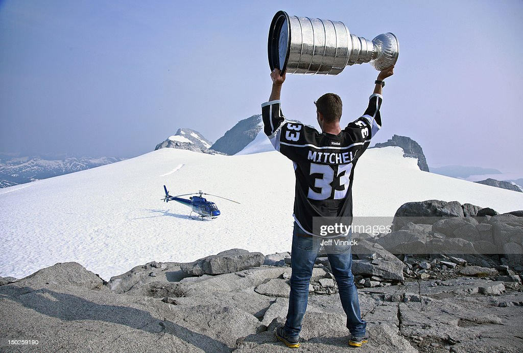 Willie Mitchell #33 of the Los Angeles Kings holds up the Stanley Cup at the top of Mount Benedict August 12, 2012 near Port McNeill, British Columbia, Canada. Mitchell took the Stanley Cup to his hometown of Port McNeill, B.C. for his one-day celebration with the prized trophy.