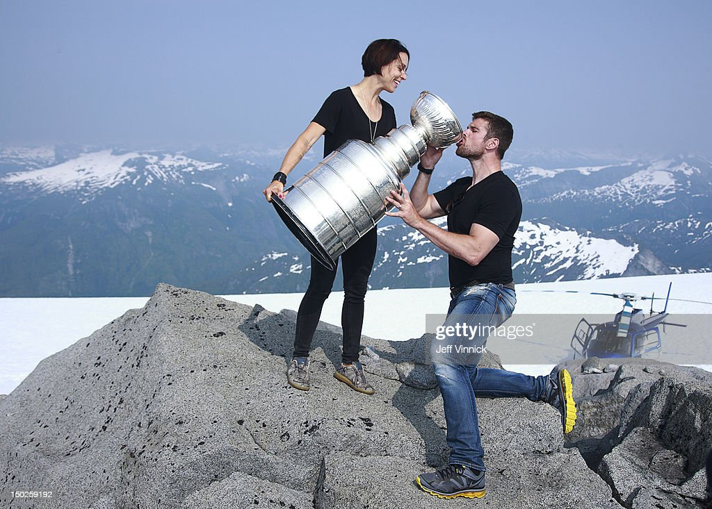 <a gi-track='captionPersonalityLinkClicked' href=/galleries/search?phrase=Willie+Mitchell+-+Ice+Hockey+Player&family=editorial&specificpeople=12876291 ng-click='$event.stopPropagation()'>Willie Mitchell</a> #33 of the Los Angeles Kings is given a drink of champagne by his wife Megan from the Stanley Cup at the top of Mount Benedict August 12, 2012 near Port McNeill, British Columbia, Canada. Mitchell took the Stanley Cup to his hometown of Port McNeill, B.C. for his one-day celebration with the prized trophy.