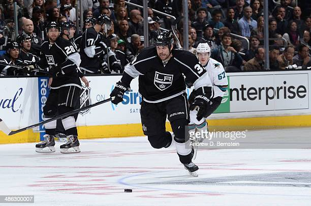 Willie Mitchell of the Los Angeles Kings skates against Tommy Wingels of the San Jose Sharks the San Jose Sharks against the Los Angeles Kings in...
