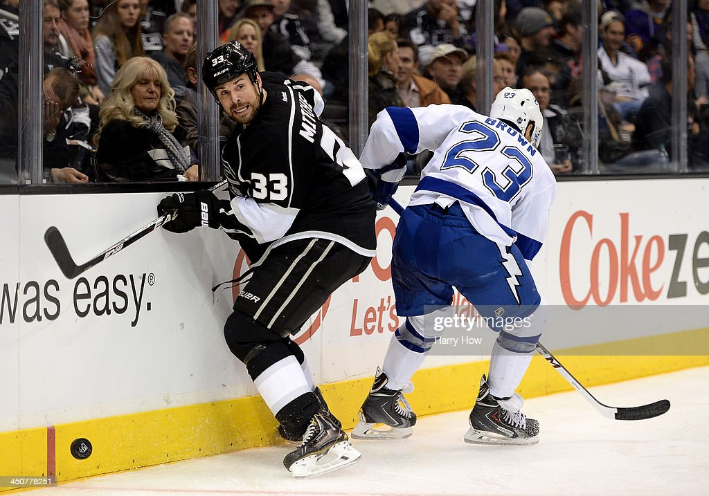 <a gi-track='captionPersonalityLinkClicked' href=/galleries/search?phrase=Willie+Mitchell+-+Ice+Hockey+Player&family=editorial&specificpeople=12876291 ng-click='$event.stopPropagation()'>Willie Mitchell</a> #33 of the Los Angeles Kings turns away from J.T. Brown #23 of the Tampa Bay Lightning at Staples Center on November 19, 2013 in Los Angeles, California.