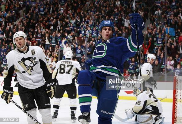 Willie Mitchell of the Vancouver Canucks celebrates his goal in front of Sergei Gonchar Sidney Crosby Mark Eaton and John Curry of the Pittsburgh...