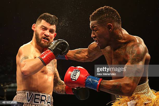 Willie Monroe Jr punches Bryan Vera during their NABA/NABO middleweight championship fight at the Turning Stone Resort Casino on January 16 2015 in...