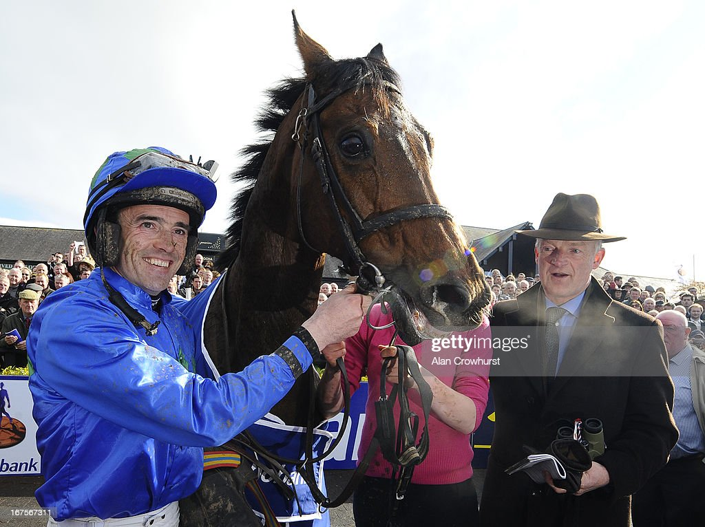 Willie Mullins (R) and <a gi-track='captionPersonalityLinkClicked' href=/galleries/search?phrase=Ruby+Walsh&family=editorial&specificpeople=171838 ng-click='$event.stopPropagation()'>Ruby Walsh</a> after riding Hurricane Fly win The Rabobank Champion Hurdle at Punchestown racecourse on April 26, 2013 in Naas, Ireland.
