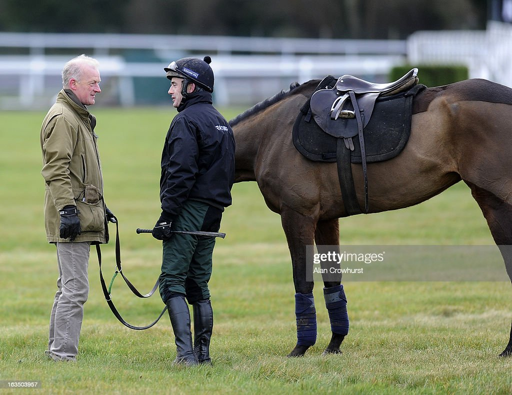 Willie Mullins (L) chats with Ruby Walsh at Cheltenham racecourse on March 11, 2013 in Cheltenham, England.