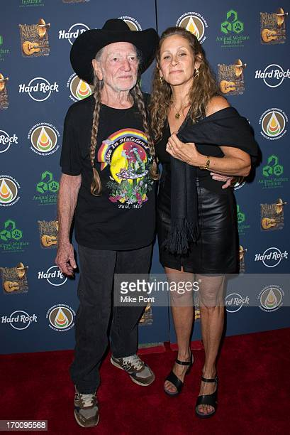 Willie Nelson and Annie D'Angelo attend Hard Rock International's Wille Nelson Artist Spotlight Benefit Concert at Hard Rock Cafe Times Square on...