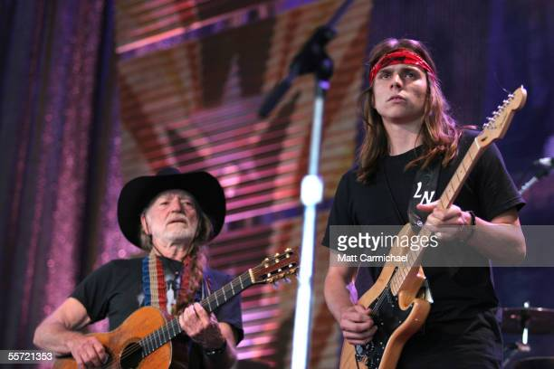 Willie Nelson and his son Luke Nelson perform live with Los Lonely Boys at the 20th Anniversary Farm Aid concert benefiting the family farmers...
