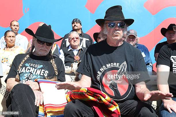 Willie Nelson and Neil Young attend a press conference before the Harvest The Hope Concert in protest of the Keystone Pipeline at the Tanderup Farm...