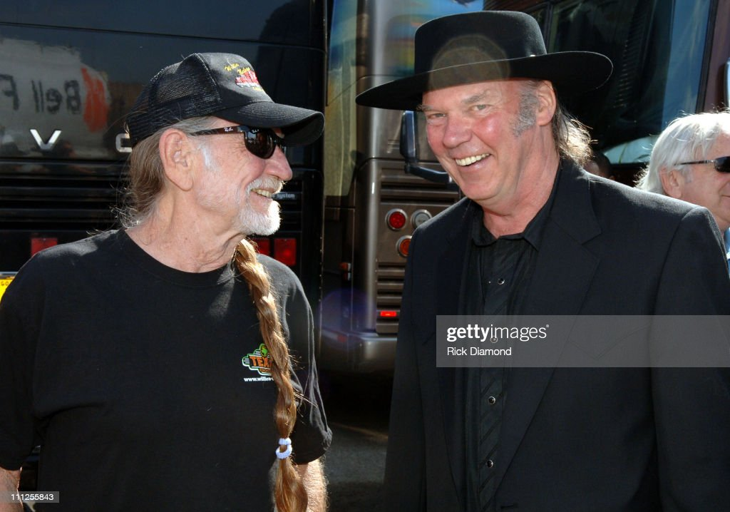 Willie Nelson and Neil Young during FARM AID 2005 Presented by SILK Soymilk at Tweeter Center in Tinley Park, Illinois, United States.
