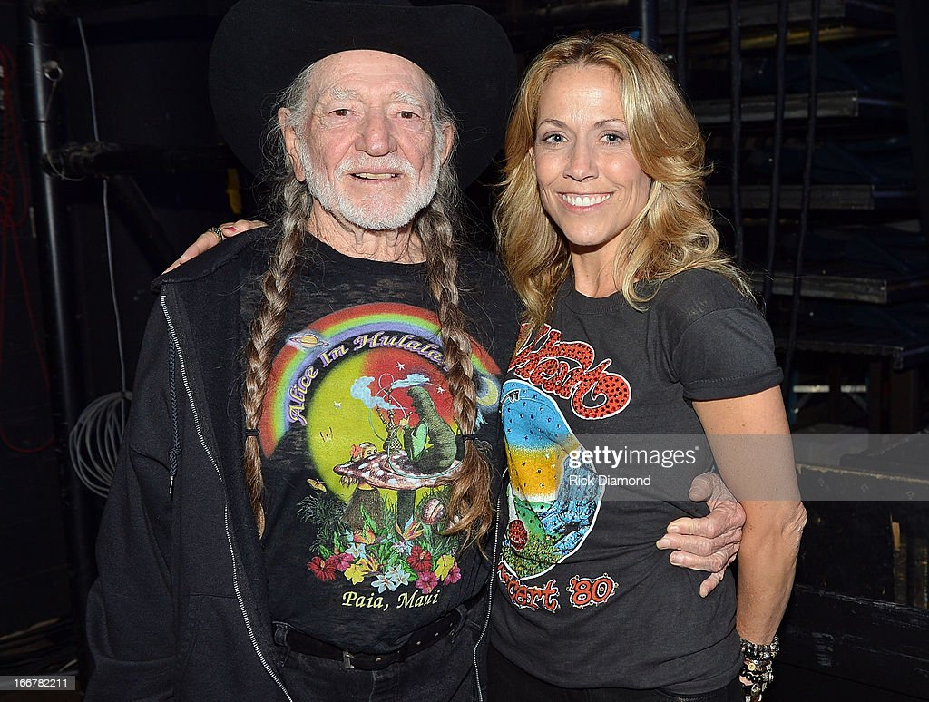 Willie Nelson and Sheryl Crow backstage during Keith Urban's Fourth annual We're All For The Hall benefit concert at Bridgestone Arena on April 16, 2013 in Nashville, Tennessee.