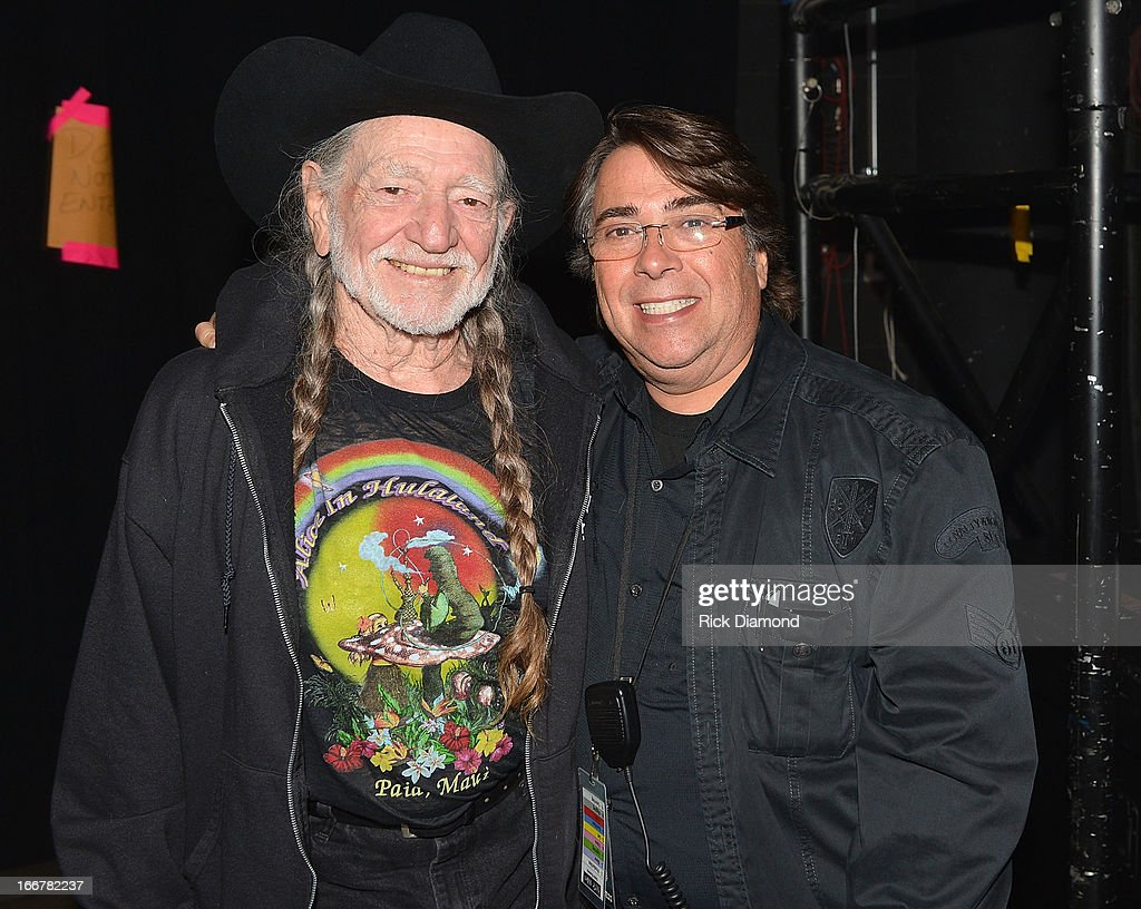 Willie Nelson and stage manager Steve Guddis performs during Keith Urban's Fourth annual We're All For The Hall benefit concert at Bridgestone Arena on April 16, 2013 in Nashville, Tennessee.