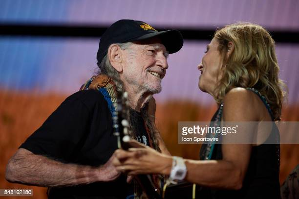 Willie Nelson greets Cheryl Crow during a concert at Farm Aid 2017 on September 16 2017 at Keybank Pavilion in Hanover Township PA