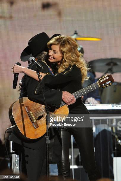 Willie Nelson is hugged by Faith Hill after performing during the 46th annual CMA awards at the Bridgestone Arena on November 1 2012 in Nashville...