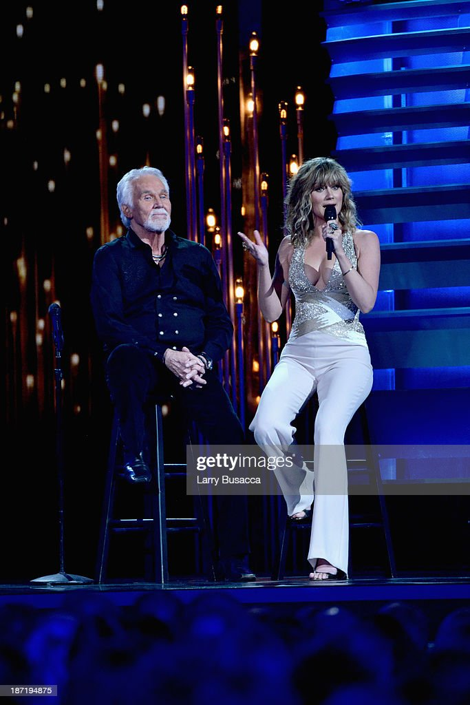 Willie Nelson Lifetime Achievement Award winner Kenny Rogers (L) and Jennifer Nettles perform onstge during the 47th annual CMA awards at the Bridgestone Arena on November 6, 2013 in Nashville, United States.