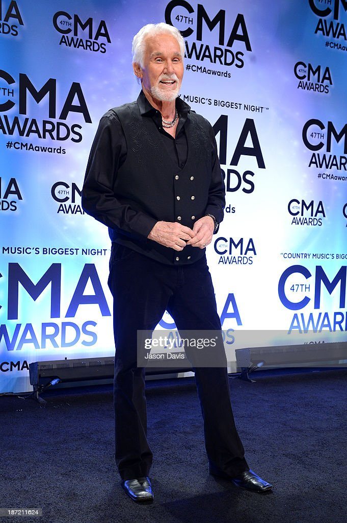 Willie Nelson Lifetime Achievement Award winner Kenny Rogers poses in the press room during the 47th annual CMA awards at the Bridgestone Arena on November 6, 2013 in Nashville, United States.